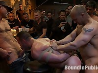 Italian bodybuilder is used and humiliated at a public bar.