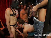 Horny men attack a hot pole dancer at a local strip joint