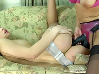 Strap-on armed babe and her sapphic girlfriend going for lez anal workout