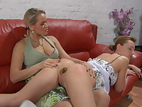 Lesbian gal gets spread and ass-fucked on the sofa by a strap-on armed babe